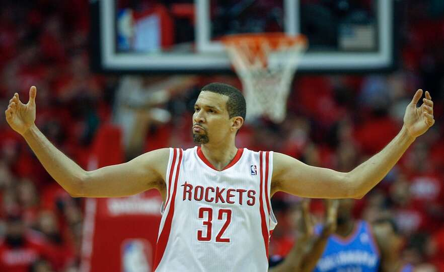 Rockets shooting guard Francisco Garcia throws his arms in the air during the first half.