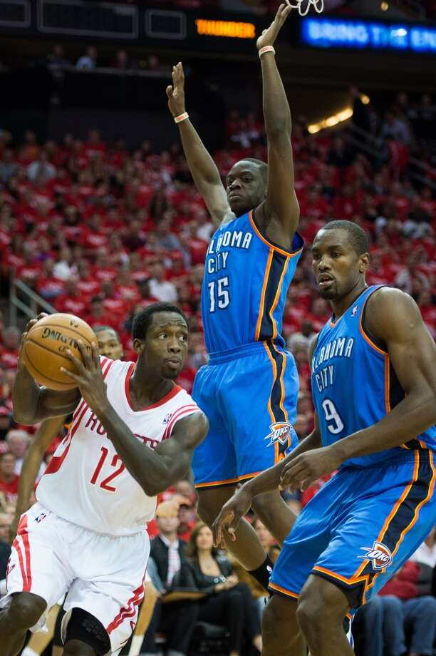 Rockets point guard Patrick Beverley (12) drives past Thunder power forward Serge Ibaka (9) and point guard Reggie Jackson (15). Photo: Smiley N. Pool, Houston Chronicle