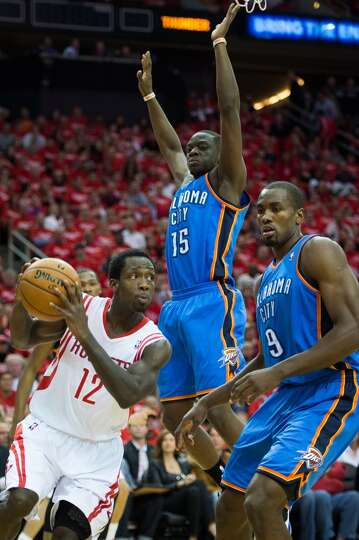 Rockets point guard Patrick Beverley (12) drives past Thunder power forward Serge Ibaka (9) and poin