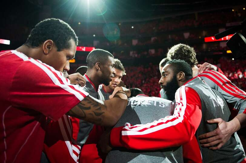 Rockets shooting guard James Harden, right, leads the team huddle before Game 6.