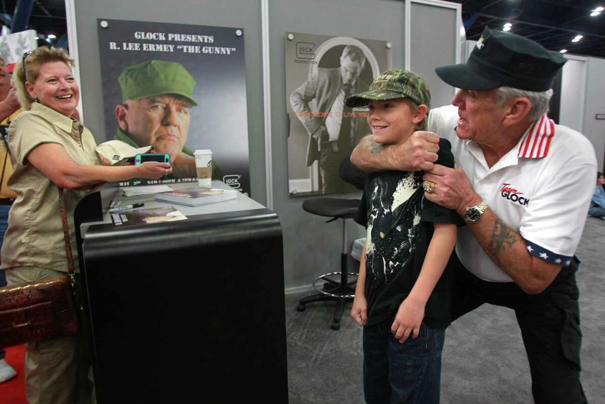 Terri Hoyt smiles as while son Ryan Hoyt, 11, is in a headlock by R. Lee Ermey