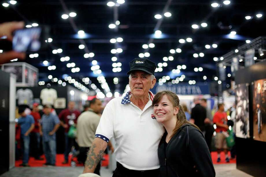 "Sharon Collins poses for a picture with ""The Gunny"", R. Lee Ermey, during day 1 of the 142nd NRA annual meetings and exhibits, Friday, May 3, 2013 at the George R Brown convention center in  (TODD SPOTH FOR THE CHRONICLE) Photo: © TODD SPOTH, 2013 / © TODD SPOTH, 2013"