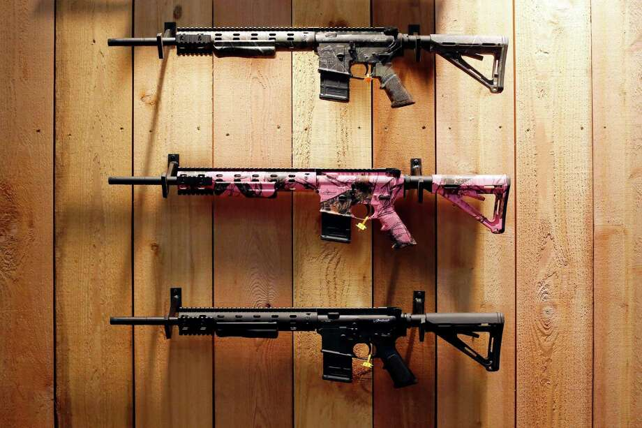 A group of rifles are seen, during day 1 of the 142nd NRA annual meetings and exhibits, Friday, May 3, 2013 at the George R Brown convention center in  (TODD SPOTH FOR THE CHRONICLE) Photo: © TODD SPOTH, 2013 / © TODD SPOTH, 2013