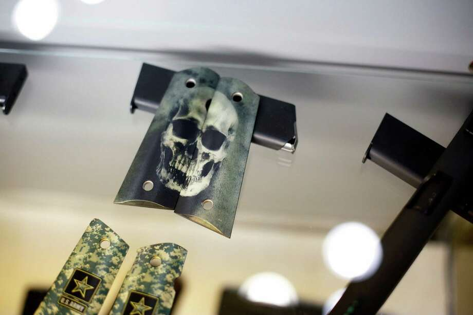 A set of decorative handgun grips is seen, during day 1 of the 142nd NRA annual meetings and exhibits, Friday, May 3, 2013 at the George R Brown convention center in  (TODD SPOTH FOR THE CHRONICLE) Photo: © TODD SPOTH, 2013 / © TODD SPOTH, 2013