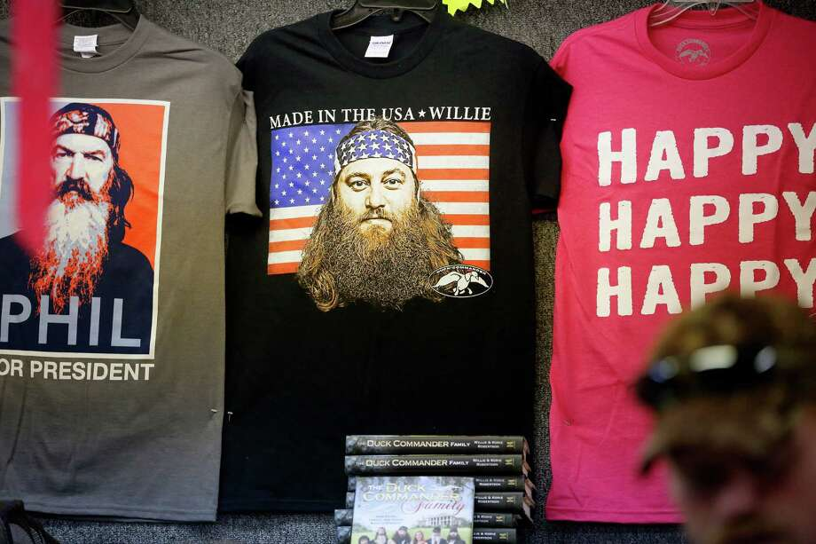 T-shirts at the Duck Dynasty merchandise trailer is seen, during day 1 of the 142nd NRA annual meetings and exhibits, Friday, May 3, 2013 at the George R Brown convention center in  (TODD SPOTH FOR THE CHRONICLE) Photo: © TODD SPOTH, 2013 / © TODD SPOTH, 2013
