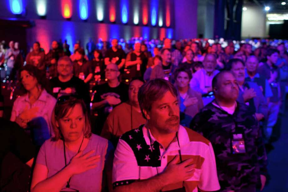 NRA attendees sing the National Anthem during the NRA-ILA Leadership Forum at the National Rifle Association's 142 Annual Meetings and Exhibits in the George R. Brown Convention Center Friday, May 3, 2013, in Houston. Photo: Johnny Hanson, Houston Chronicle / © 2013  Houston Chronicle