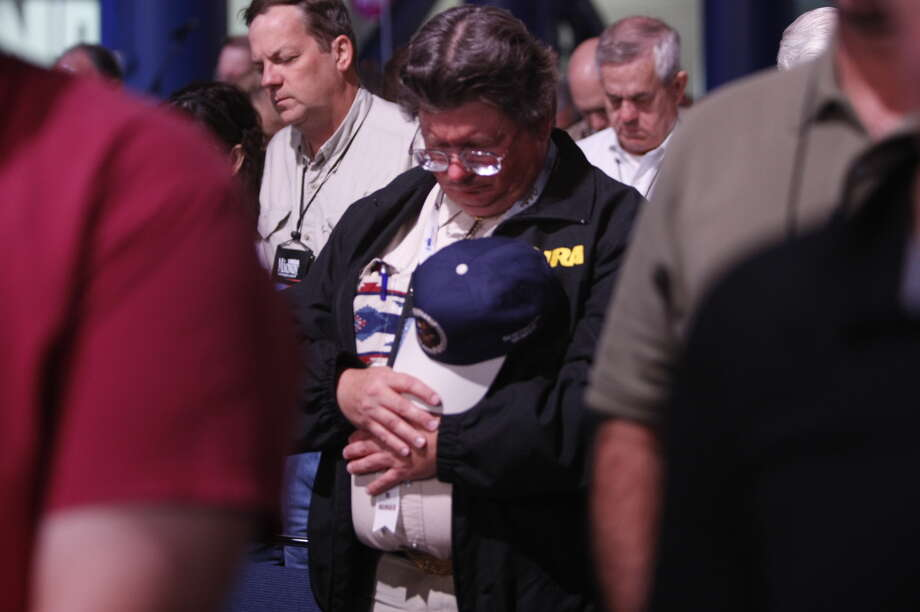 Prayer at the NRA meeting in downtown Houston. Photo: Johnny Hanson/Chronicle