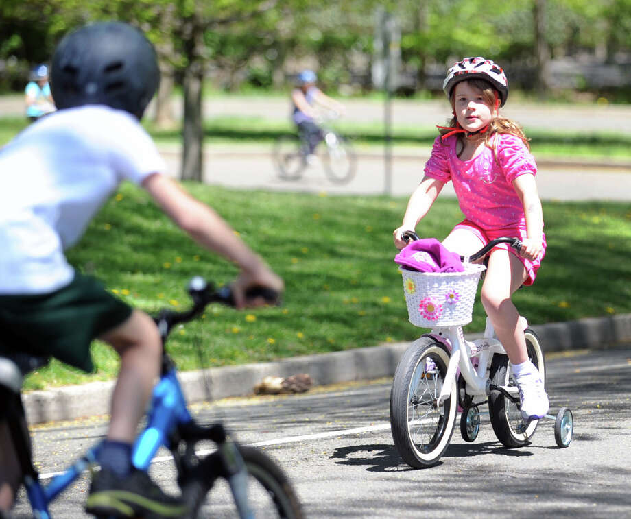 Anna Zajac, 7, of Greenwich, participates in the Bicycle Rodeo at the Julian Curtiss School in Greenwich, Saturday, May 4, 2013. The event, held  as part of National Bike Month to promote bicycle safety and the health benefits of biking, was sponsored by the Julian Curtiss School P.T.A, the YMCA of Greenwich, Greenwich Safe Cycling, and the Greenwich Police Silver Shield Association. Jamie Cahill of the Julian Curtiss School P.T.A. said more than sixty children attended the event. Photo: Bob Luckey / Greenwich Time
