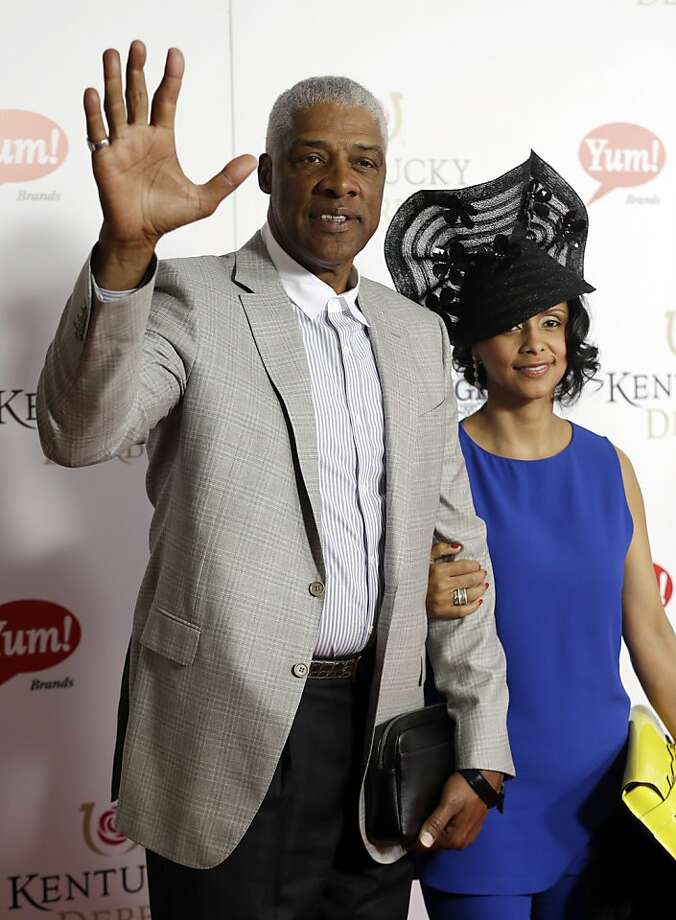 """Former NBA player Julius """"Dr. J"""" Irving arrives with his wife Dorys to attend the 139th Kentucky Derby at Churchill Downs Saturday, May 4, 2013, in Louisville, Ky. Photo: Darron Cummings, Associated Press"""