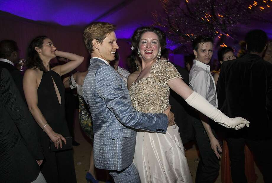 Luke Willis dances with Erin Mahone during the after party for San Francisco Ballet's Cinderella Opening Night Ball in a tent outside War Memorial Opera House in San Francisco, Calif., on Friday, May 3, 2013.  The party celebrated the opening night and United States premiere of choreographer Christopher Wheeldon's production of Cinderella. Photo: Laura Morton, Special To The Chronicle