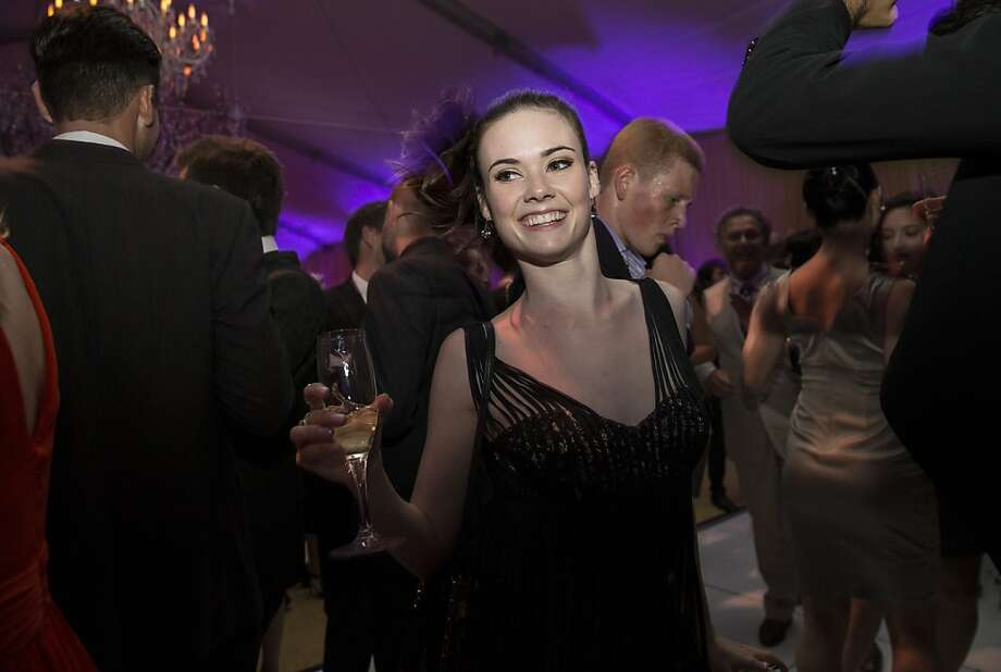 Elizabeth Powell, a member of San Francisco Ballet's corps de ballet, enjoys the dance floor during the after party for the Cinderella Opening Night Ball in a tent outside War Memorial Opera House in San Francisco, Calif., on Friday, May 3, 2013.  The party celebrated the opening night and United States premiere of choreographer Christopher Wheeldon's production of Cinderella. Photo: Laura Morton, Special To The Chronicle