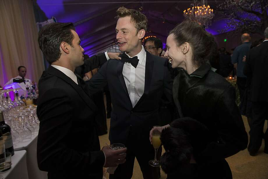 Joan Boada (left) and Maria Kochetkova, both San Francisco Ballet principal dancers, talk with choreographer Christopher Wheeldon during the after party at the Cinderella Opening Night Ball in a tent outside War Memorial Opera House in San Francisco, Calif., on Friday, May 3, 2013.  Boada and Kochetkova danced the lead roles during the opening night of Wheeldon's production of Cinderella. Photo: Laura Morton, Special To The Chronicle
