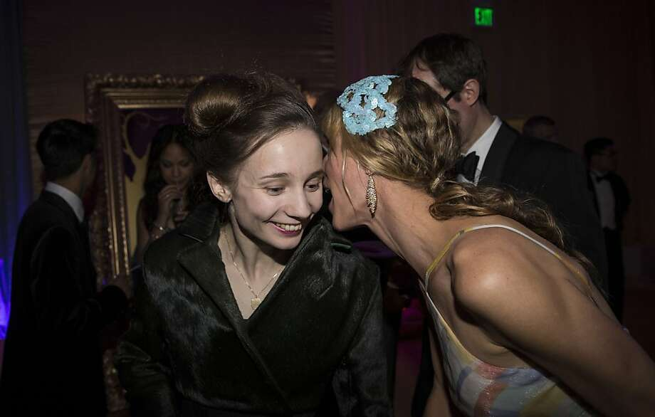 Maria Kochetkova, a Principal Dancer with the San Francisco Ballet, receives congratulations on her performance from Melissa Barber (right) during the after party at the Cinderella Opening Night Ball in San Francisco, Calif., on Friday, May 3, 2013.  Kochetkova danced the lead role in the opening night of Christopher Wheeldon's production of Cinderella. Photo: Laura Morton, Special To The Chronicle