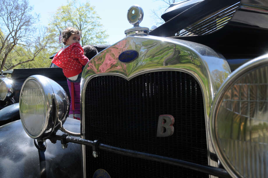 Panni Gergely, 2, looks over a 1930 Model A Ford at the Stamford Museum and Nature Center's 10th Annual Model Ts to Mustangs Antique and Classic Car Show in Stamford Conn., May 4, 2013. Photo: Keelin Daly / Stamford Advocate Freelance