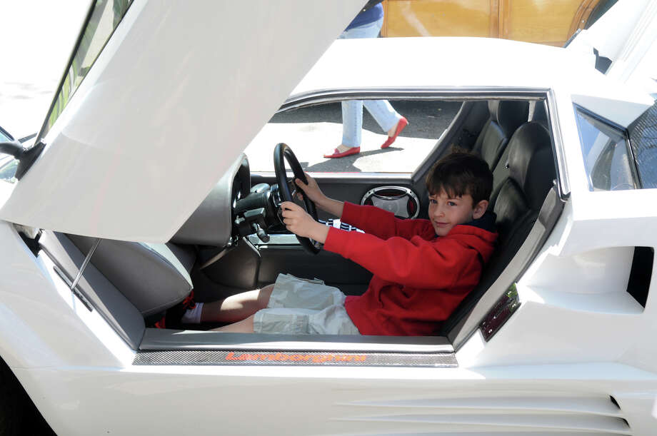 Riccardo De Corato, 6, takes the wheel of a 1988 Lamborghini at the Stamford Museum and Nature Center's 10th Annual Model Ts to Mustangs Antique and Classic Car Show in Stamford Conn., May 4, 2013. Photo: Keelin Daly / Stamford Advocate Freelance