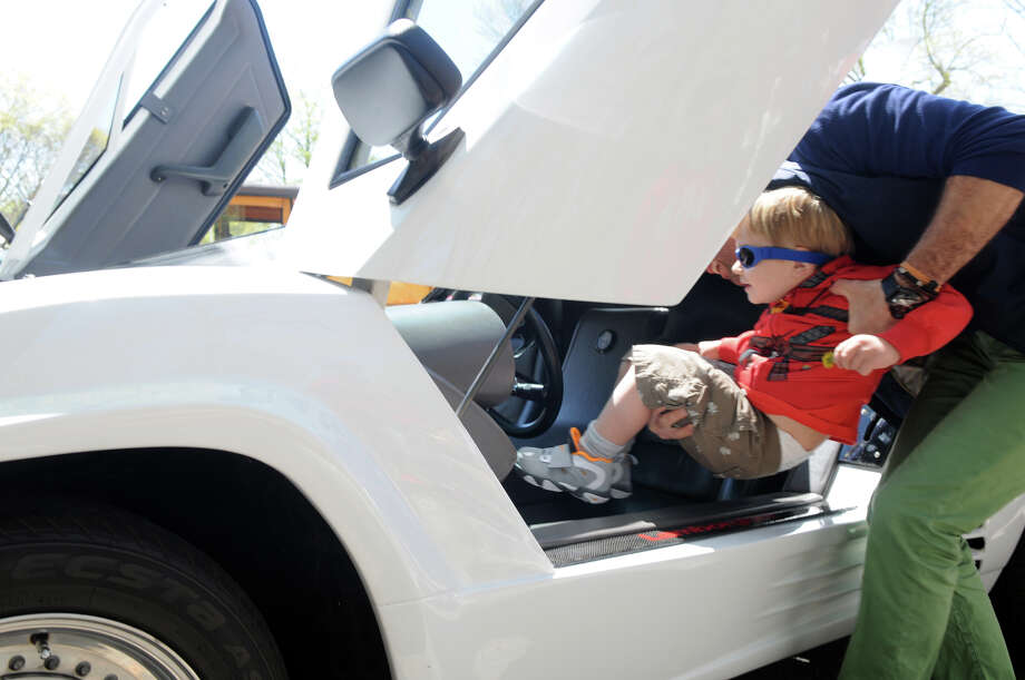Matteo De Corato, 6, gets a lift into a 1988 Lamborghini at the Stamford Museum and Nature Center's 10th Annual Model Ts to Mustangs Antique and Classic Car Show in Stamford Conn., May 4, 2013. Photo: Keelin Daly / Stamford Advocate Freelance