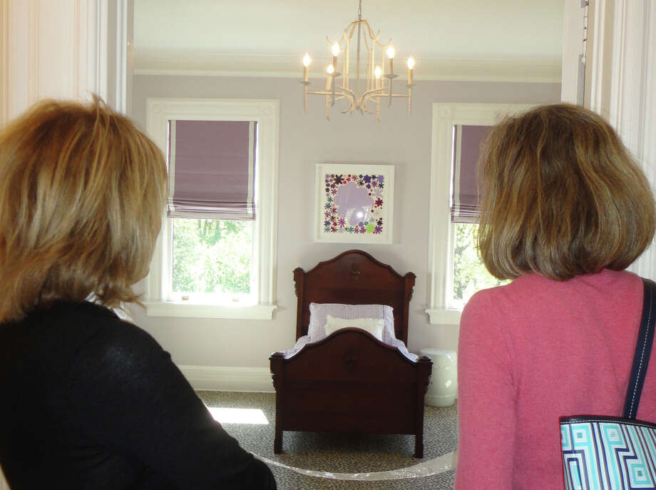 Two women look at the interior design work of Ruger Interiors, in one of the children's bedrooms in a Fairfield home, one of five houses featured on the annual Designer House Tour sponsored by Near & Far Aid. Photo: Meg Barone / Westport News contributed