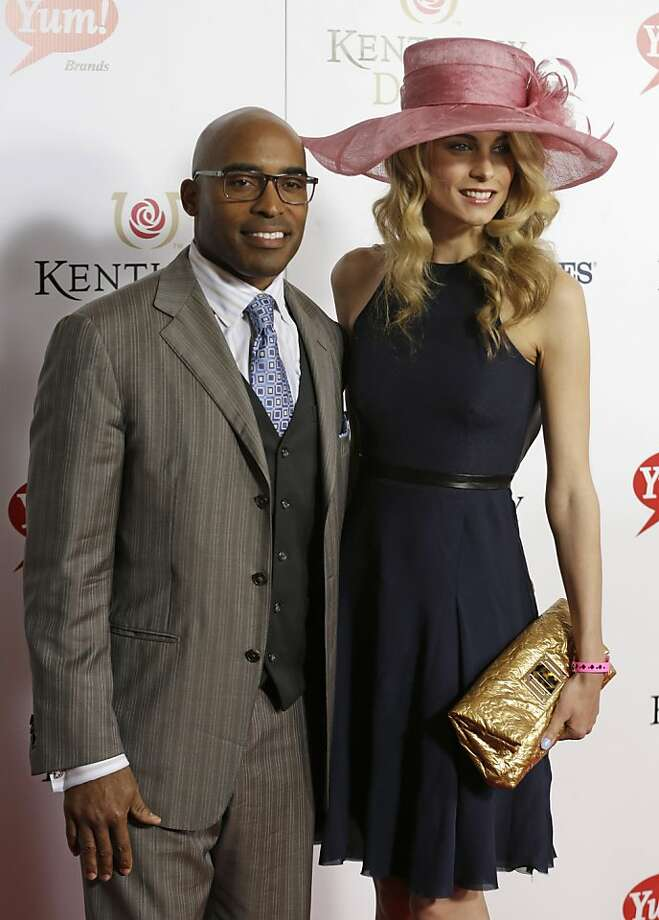 Former NFL player Tikki Barber arrives with his wife Ginny to attend the 139th Kentucky Derby at Churchill Downs Saturday, May 4, 2013, in Louisville, Ky. (AP Photo/Darron Cummings) Photo: Darron Cummings, Associated Press