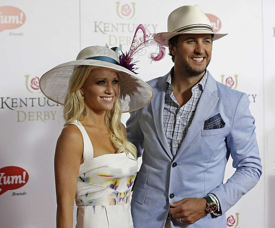 Country singer Luke Bryan arrives with his wife Caroline to attend the 139th Kentucky Derby at Churchill Downs Saturday, May 4, 2013, in Louisville, Ky. (AP Photo/Darron Cummings) Photo: Darron Cummings, Associated Press