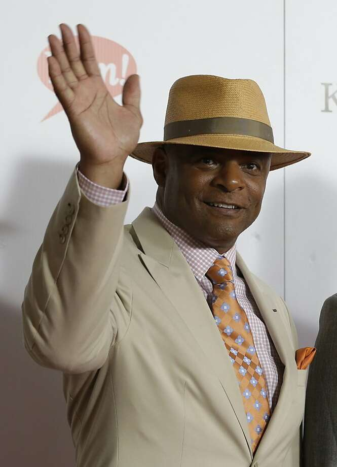 Former NFL player Warren Moon arrives to attend the 139th Kentucky Derby at Churchill Downs Saturday, May 4, 2013, in Louisville, Ky. (AP Photo/Darron Cummings) Photo: Darron Cummings, Associated Press