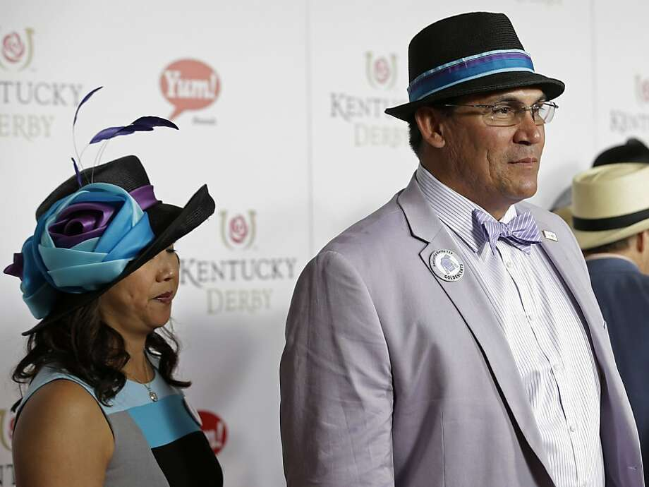 Carolina Panthers head coach Ron Rivera arrives with his wife Stephanie to attend the 139th Kentucky Derby at Churchill Downs Saturday, May 4, 2013, in Louisville, Ky. (AP Photo/Darron Cummings) Photo: Darron Cummings, Associated Press