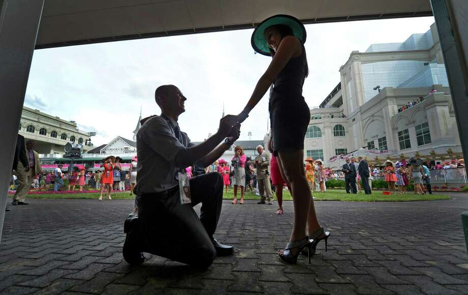 Joey Miller of Broadway, VA  proposes to his fiance Shawnna Erdos of Cadiz, OH. at Churchill Downs May 3, 2013, in Louisville, Kentucky.   (Skip Dickstein/Times Union) Photo: SKIP DICKSTEIN