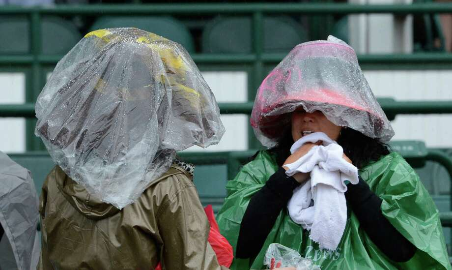 Stalwart racing fans tough out the rain to have their Kentucky Derby Experience at Churchill Downs May 4, 2013 in Louisville, Kentucky.    (Skip Dickstein/Times Union) Photo: SKIP DICKSTEIN