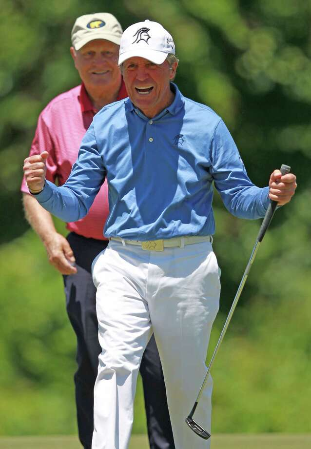 Gary Player reacts after making birdie on No. 2 as playing partner Jack Nicklaus looks on during the Greats of Golf exhibition at the Insperity Championship, Saturday, May 4, 2013 at The Woodlands Country Club Tournament Course in The Woodlands, TX. Photo: Eric Christian Smith, For The Chronicle