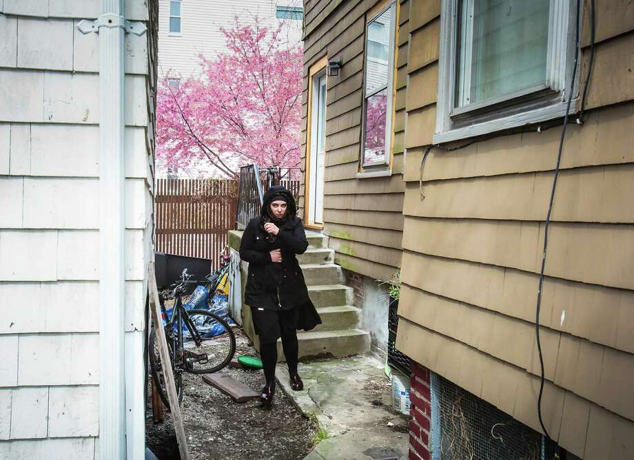Katherine Russell outside the building where she, Tamerlan Tsarnaev and their daughter lived in Cambridge, Mass. Her husband was a suspect in the Boston Marathon bombing who later died in a standoff with police. Photo: EVAN MCGLINN, STR / NYTNS