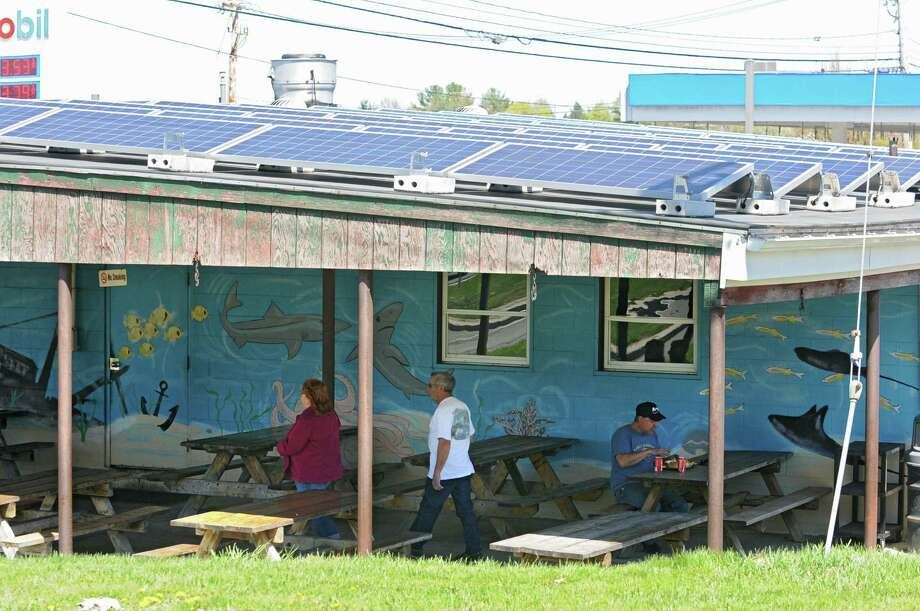Solar panels that were installed by Monolith Solar on the roof of Gene's Fish Fry on Friday, May 3, 2013 in East Greenbush, N.Y.   (Lori Van Buren / Times Union) Photo: Lori Van Buren / 10022274A
