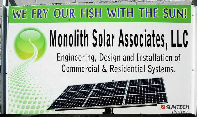 A sign advertising Solar panels that were installed by Monolith Solar on the roof of Gene's Fish Fry on Friday, May 3, 2013 in East Greenbush, N.Y.   (Lori Van Buren / Times Union) Photo: Lori Van Buren / 10022274A