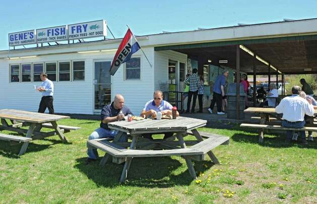 Customers eat al fresco at Gene's Fish Fry on Friday, May 3, 2013 in East Greenbush, N.Y.  Solar panels were installed by Monolith Solar on the roof of Gene's Fish Fry. (Lori Van Buren / Times Union) Photo: Lori Van Buren / 10022274A