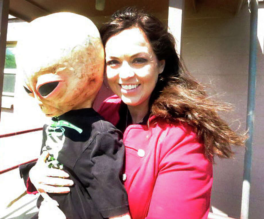 "Aurora's city administrator Toni Kelly believes her little friend ""Ned"" could be the focal point of an Aurora UFO festival. According to the Aurora legend, townspeople buried the UFO pilot and threw the wreckage down a well. Photo: Joe Holley, Staff / © 2013 Houston Chronicle"