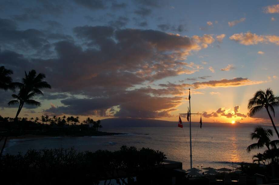 No. 7: Hawaii. 'It's No. 1 in having R&R for all ages,' Cohen says, noting that Mitch-Stuart clients' favorite islands are Maui and Kauai, respectively.  'It's beautiful. People who want to chill out choose Hawaii,' she adds. Pictured: Sunset as seen from Maui's Napili Kai Beach Resort.