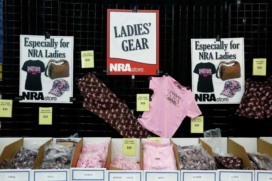 A display of NRA merchandise for ladies is seen, during day 1 of the 142nd NRA annual meetings and exhibits, Friday, May 3, 2013 at the George R Brown convention center in  (TODD SPOTH FOR THE CHRONICLE) Photo: © TODD SPOTH, 2013 / © TODD SPOTH, 2013