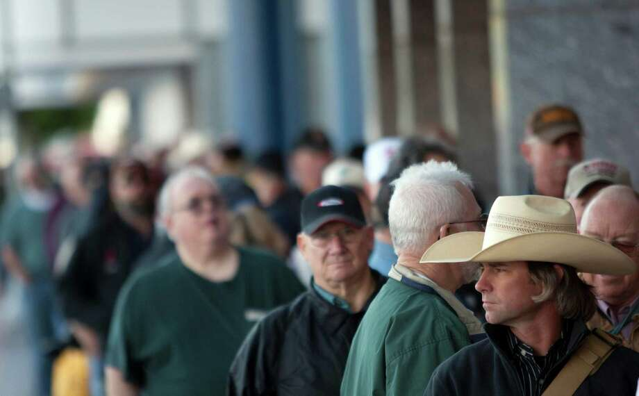 Wade Anders of Lufkin waits in line before entering the exhibit hall during the NRA-ILA Leadership Forum at the National Rifle Association's 142 Annual Meetings and Exhibits in the George R. Brown Convention Center Friday, May 3, 2013, in Houston. Photo: Johnny Hanson, Houston Chronicle / © 2013  Houston Chronicle