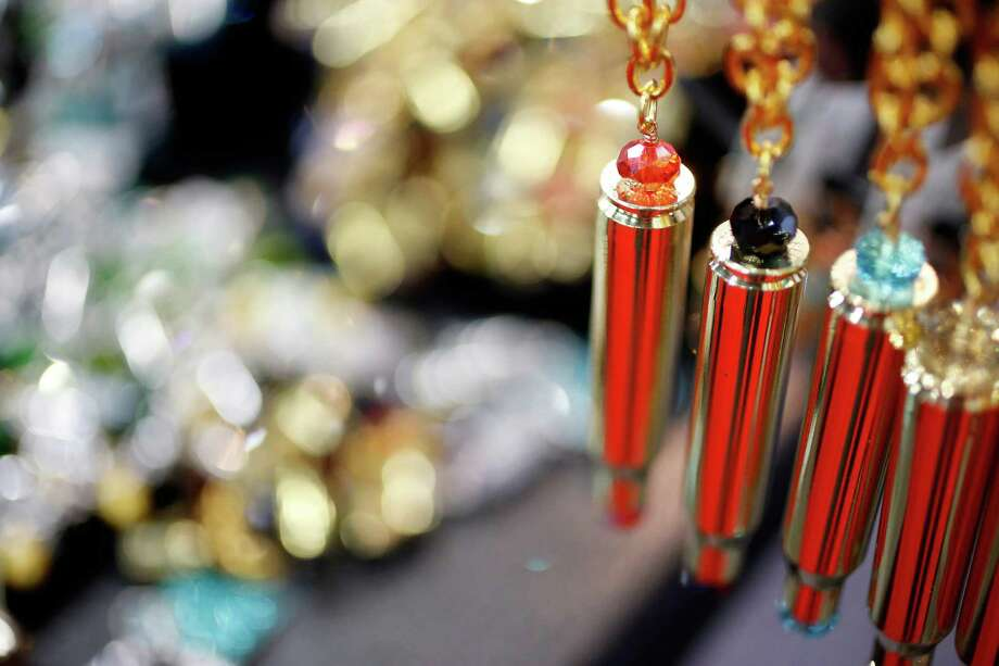 Decorative jewelry featuring used ammo casings at the Kodiak Arms booth is seen, during day 1 of the 142nd NRA annual meetings and exhibits, Friday, May 3, 2013 at the George R Brown convention center in  (TODD SPOTH FOR THE CHRONICLE) Photo: © TODD SPOTH, 2013 / © TODD SPOTH, 2013