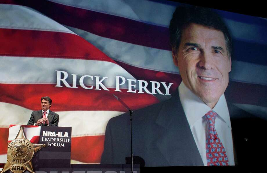 Gov. Rick Perry speaks during the NRA-ILA Leadership Forum at the National Rifle Association's 142 Annual Meetings and Exhibits in the George R. Brown Convention Center Friday, May 3, 2013, in Houston. Photo: Johnny Hanson, Houston Chronicle / © 2013  Houston Chronicle
