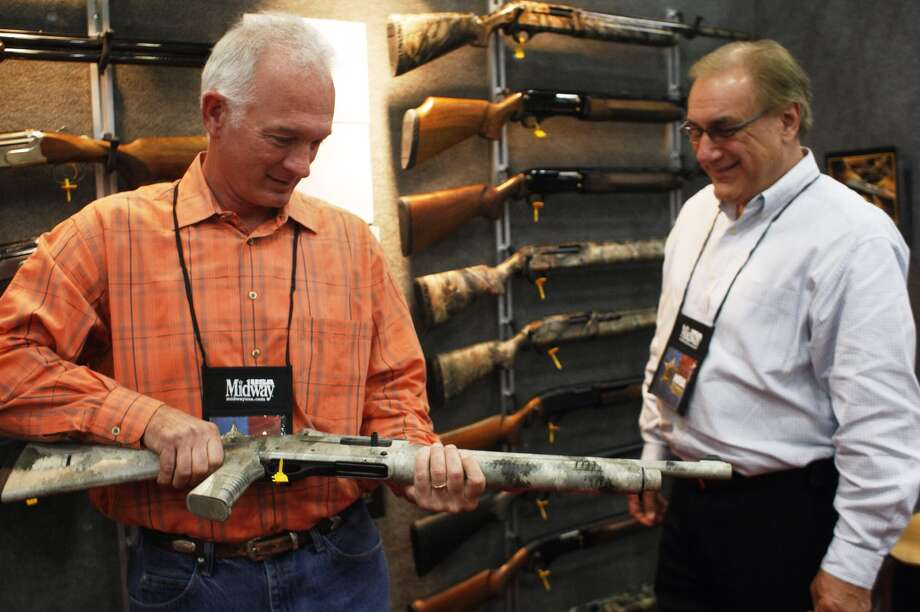New NRA members Joey Sullivan, left, of Montgomery, and Tim Armand of Houston. Photo: Johnny Hanson/Chronicle