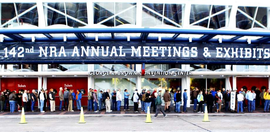 Convention goers line up outside of the George R. Brown Convention Center in Houston, site of the 2013 NRA Convention, Friday, May 3, 2013. Photo: Johnny Hanson