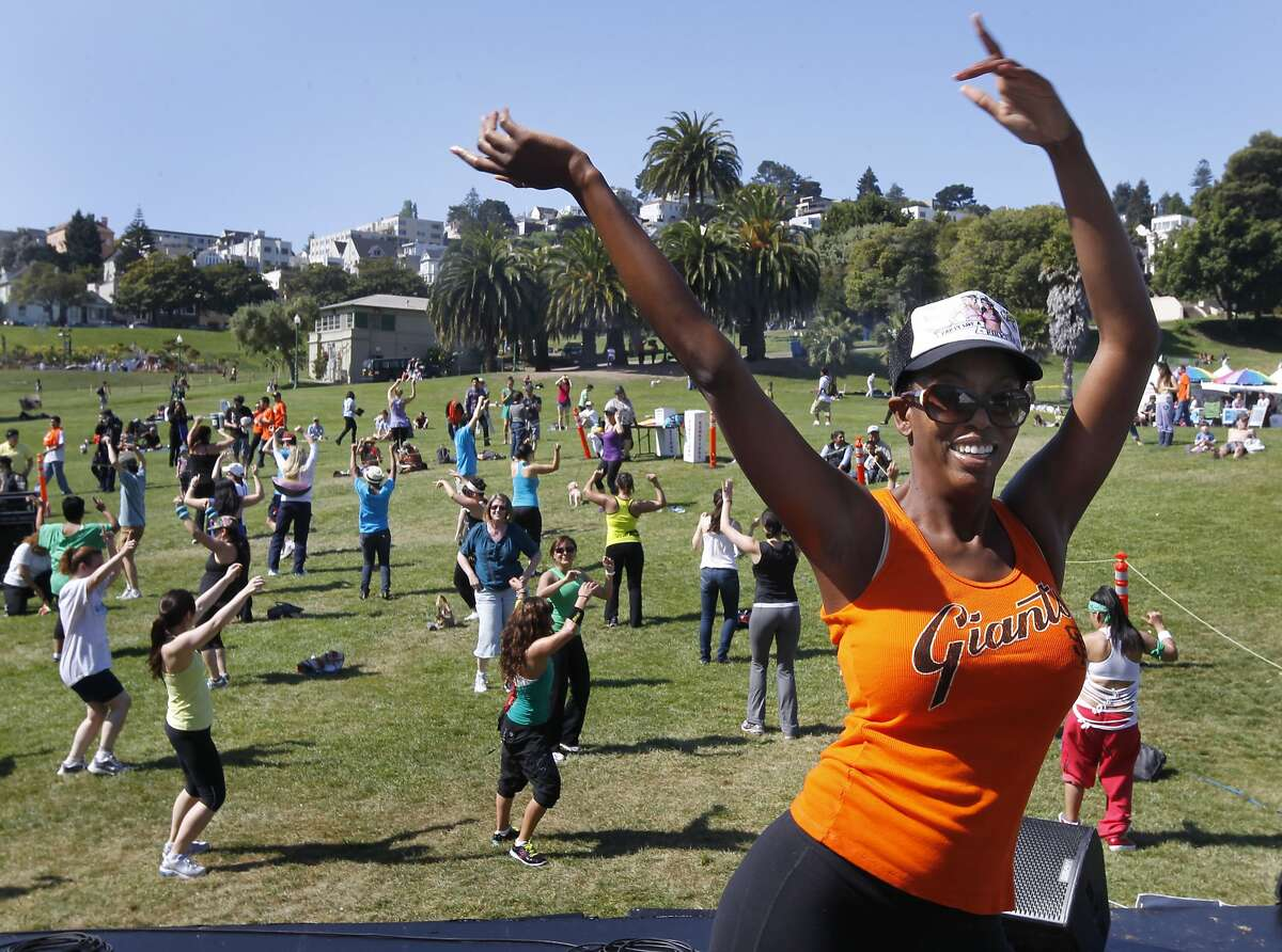 Eboniña Evans leads a Zumba-thon exercise dance session to kickoff the annual Cinco de Mayo celebration at Dolores Park in San Francisco, Calif. on Saturday, May 4, 2013.