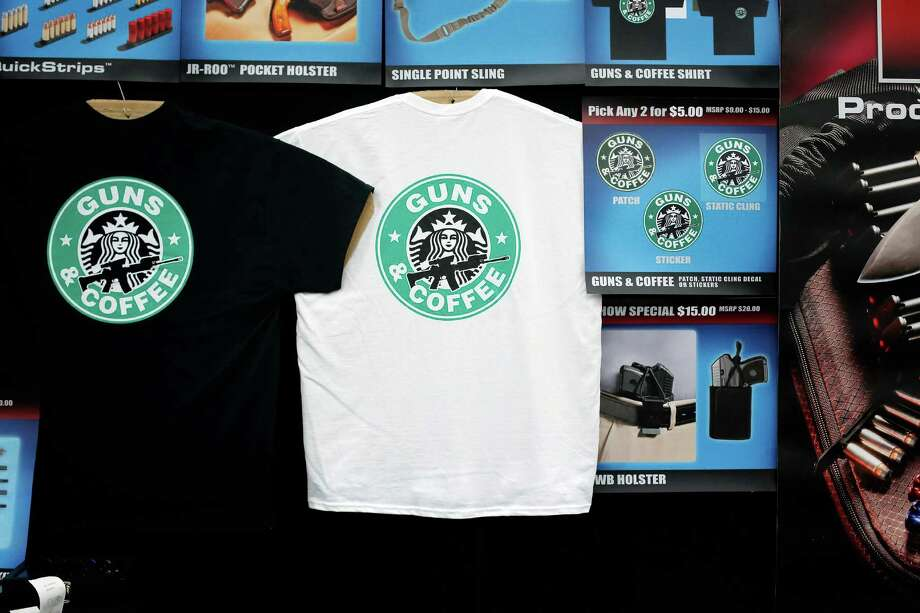 A t-shirt featuring a parody of the Stabucks logo is seen, during day 1 of the 142nd NRA annual meetings and exhibits, Friday, May 3, 2013 at the George R Brown convention center in  (TODD SPOTH FOR THE CHRONICLE) Photo: © TODD SPOTH, 2013 / © TODD SPOTH, 2013