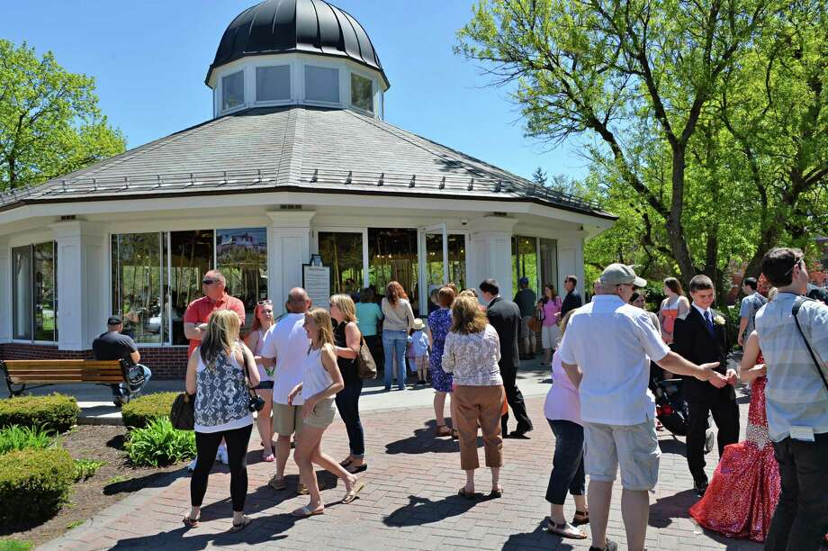 Patrons crowd the Congress Park Carousel as it opens for the season in Saratoga Springs, NY Saturday, May 4, 2013. The carousel will be open on weekends until June 21, after that, it will be open seven days a week until Labor Day. (John Carl D'Annibale / Times Union) Photo: John Carl D'Annibale / 10022188A