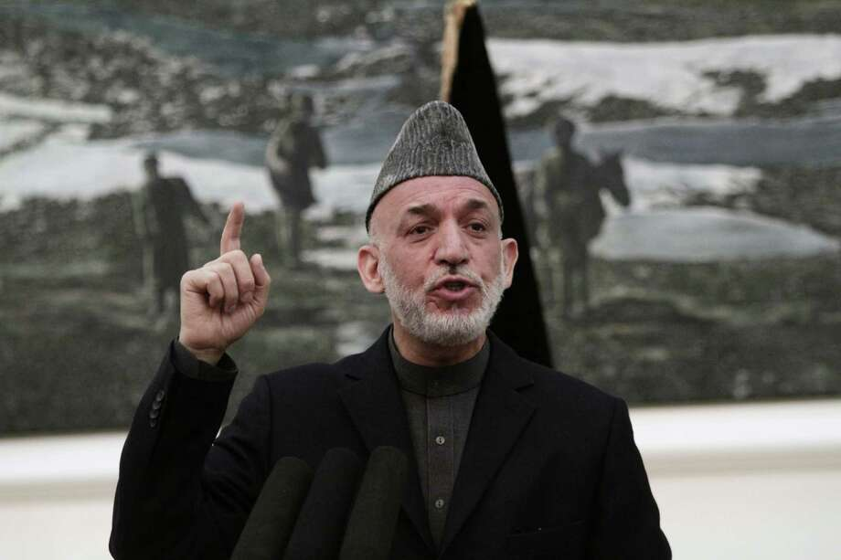 Afghan President Hamid Karzai, at a news conference on Saturday in Kabul, said the CIA has assured him that regular cash infusions his government receives from the agency will not be cut off. Photo: Rahmat Gul, STR / AP