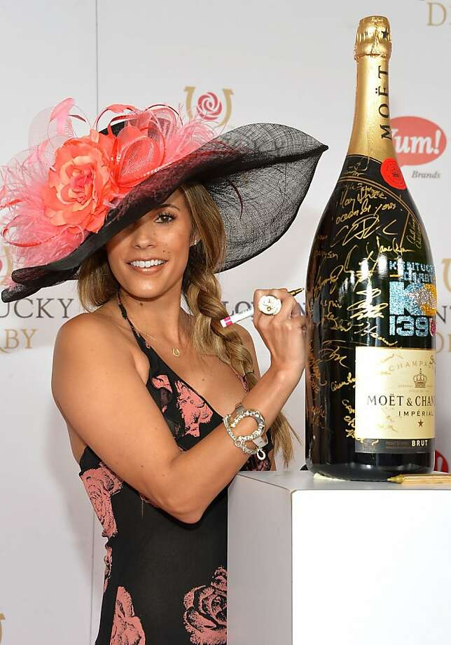 LOUISVILLE, KY - MAY 04:  Bonnie-Jill Laflin signs the Moet & Chandon 6L for the Churchill Downs Foundation during the 139th Kentucky Derby at Churchill Downs on May 4, 2013 in Louisville, Kentucky.  (Photo by Mike Coppola/Getty Images for Moet & Chandon) Photo: Mike Coppola, Getty Images For Moet & Chandon