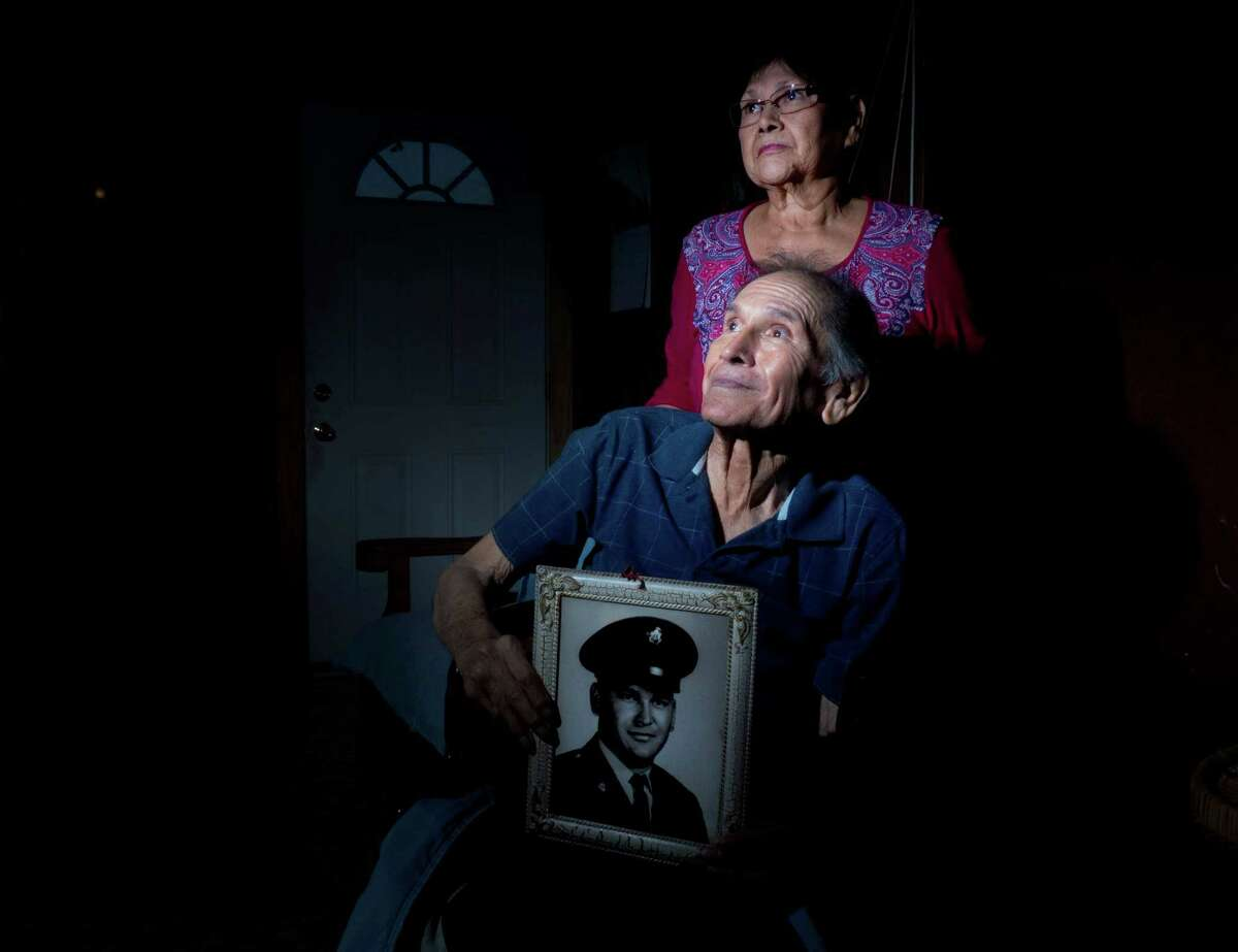 Modesto Rodriguez, 71, who in 1975 testified in favor of the Voting Rights Act applying to Texas, sits at home with his sister, Modesta Rodriguez Salazar, 69, in Pearsall on Friday, May 3, 2013. Rodriguez, former chairman of the Frio County Raza Unida Party, was beaten in Pearsall shortly after after testifying, allegedly for his stance, said his sister, Modesta Rodriguez Salazar. He has suffered a stroke and is in poor health. He holds a portrait of himself in Army uniform, taken in the 1960s.