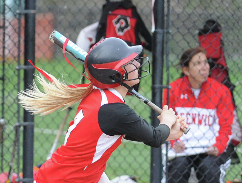 Rebecca DeCarlo of Greenwich hits a bases-clearing triple driving in 3 runs during a 13-1 win over Wilton. DeCarlo is one of the top hitters for the Cardinals, who are averaging an FCIAC-best 10.7 runs per game. Photo: Bob Luckey / Greenwich Time