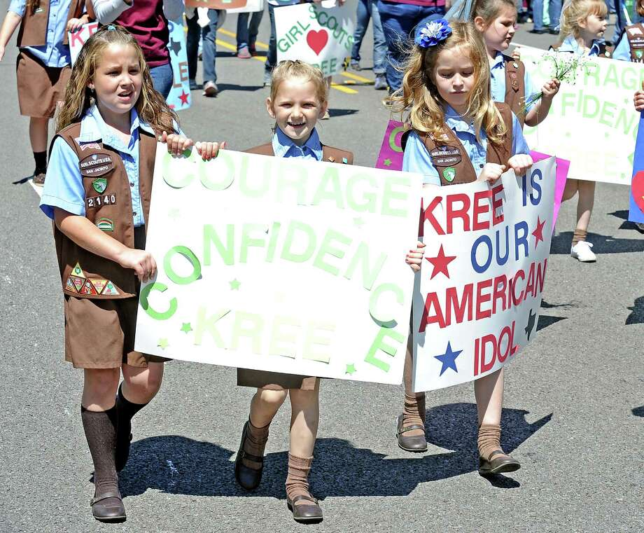 Hundreds take the streets of US-190 in Woodville to see Kree Harrison parade through on Saturday, May 4, 2013. Photo taken: Randy Edwards/The Enterprise