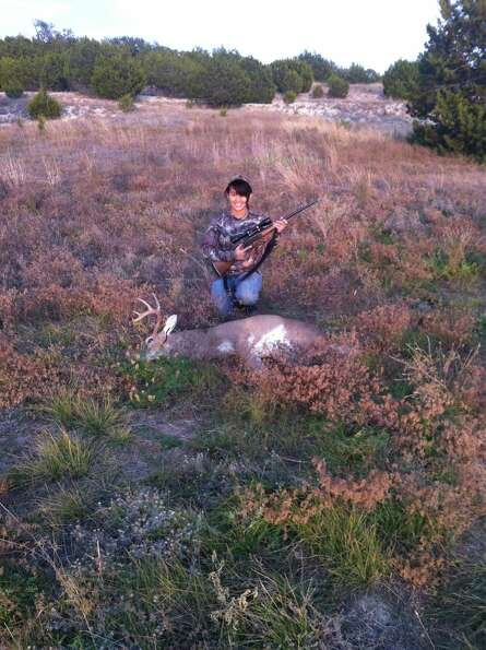 Lian Helfrich, 12, with her first deer harvested in Lampasas County in November 2012.