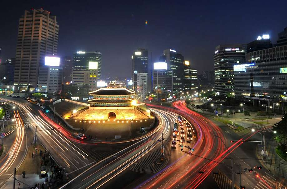 Legendary gate rises from the ashes: A long-exposure photo shows traffic commuting near the Namdaemun Gate in Seoul. On Saturday, South Korea 